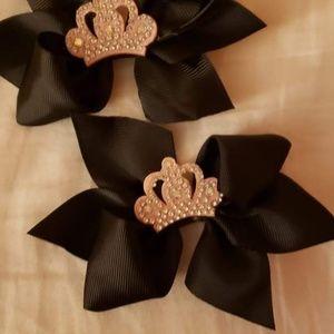 2 black pigtail hair bows